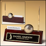 BC525 Rosewood piano finish nameplate with pen, business card holder, and goldtone metal golf ball / clock.